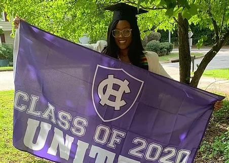 Stephanie holding banner